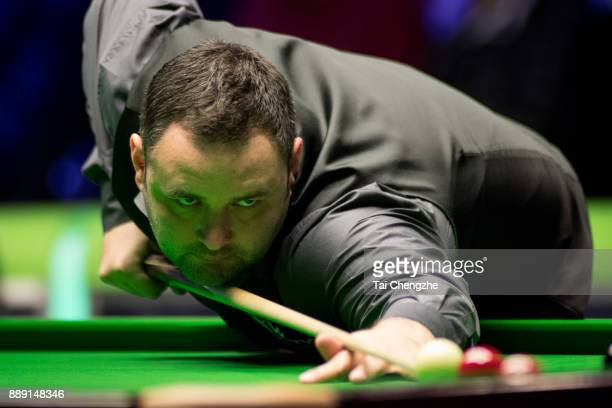 Stephen Maguire of Scotland plays a shot in the semifinal match against Ronnie O'Sullivan of England during 2017 Betway UK Championship at Barbican...