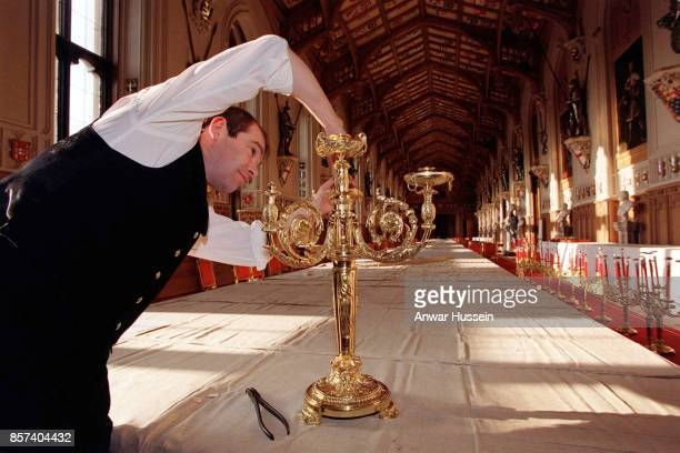 Stephen Marshall assistant Yeoman of the Glass Pantry prepares for a State Visit banquet by the German President in St Georges Hall at Windsor Castle...