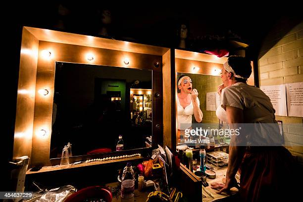 Stephen Matthews playing 'Dame' applies make up in his dressing room prior to going onstage for the Puss in Boots pantomime at the Hackney Empire on...
