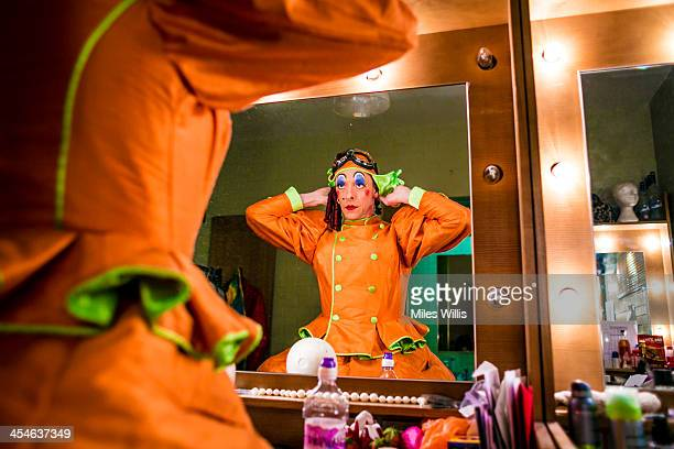 Stephen Matthews playing 'Dame' applies the final touches in his dressing room to his costume prior to going onstage for the Puss in Boots pantomime...