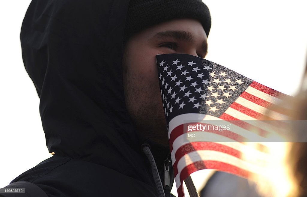 Stephen McCarter, of Chesterfield, Virginia, stayed overnight with friends so that he could be on the National Mall early for the inauguration of U.S. President Barack Obama in Washington, D.C., Monday, January 21, 2013.
