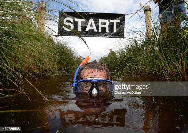 Stephen McDonagh takes part in the Irish Bog Snorkelling championship at Peatlands Park on July 27 2014 in Dungannon Northern Ireland The annual...