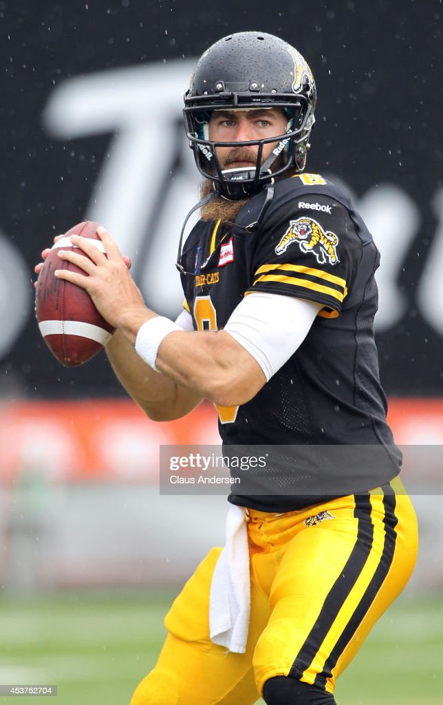 Stephen McGee of the Hamilton TigerCats warms up prior to play against the Calgary Stampeders in a CFL game at Ron Joyce Stadium on August 16 2014 in...