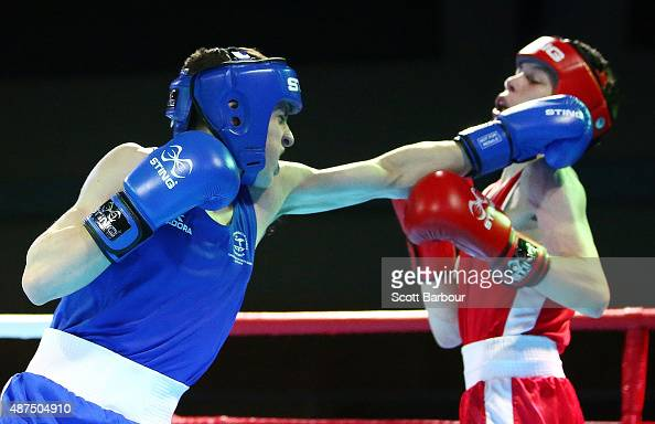 Stephen McKenna of Northern Ireland and Tyler Blizzard of Australia box during the Youth's Light 49kg Men Boxing Final at the Tuanaimato Sports...