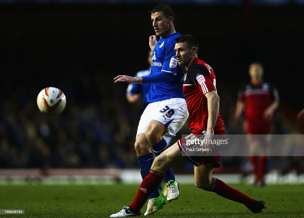 Stephen McManus of Bristol City battles for the ball with Chris Wood of Leicester City during the npower Championship match between Bristol City and Leicester City at Ashton Gate on January 12, 2013 in Bristol, England.