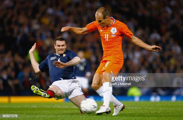 Stephen McManus of Scotland tackles Arjen Robben of Netherlands during the FIFA 2010 World Cup Group 9 Qualifier match beteween Scotland and...