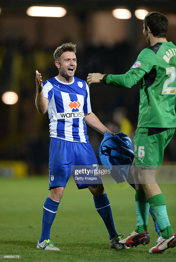 Stephen McPhail celebrates with team mate Damian Martinez of Sheffield Wednesday at the end of the Sky Bet Championship match between Watford and Sheffield Wednesday at Vicarage Road on December 14, 2013 in Watford, England,