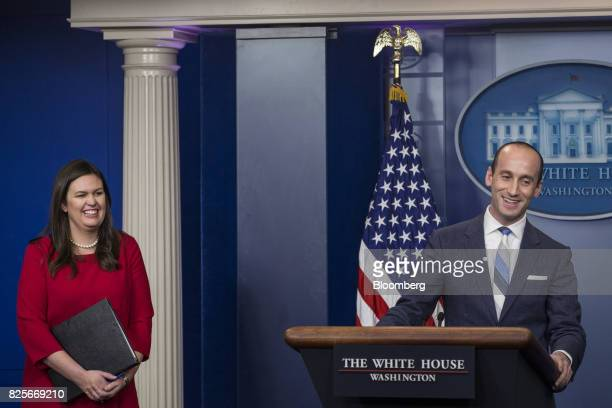 Stephen Miller White House senior advisor for policy right and Sarah Huckabee Sanders White House press secretary laugh during a White House press...