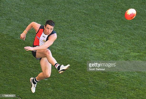 Stephen Milne of the Saints attempts to kick a goal during the round 23 AFL match between the St Kilda Saints and the Fremantle Dockers at Etihad...