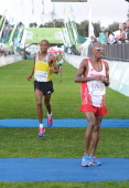Stephen Mokoka and Lusapho April are shown after the Old Mutual Two Oceans Men's Half Marathon during the Old Mutual Two Oceans Marathon on March 30...