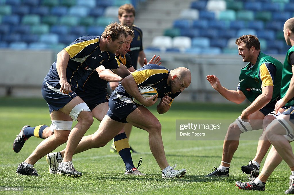 Stephen Moore charges upfield with Ben McCalman and Mark Chisholm in support during an Australian Wallabies training session held at the Moses...