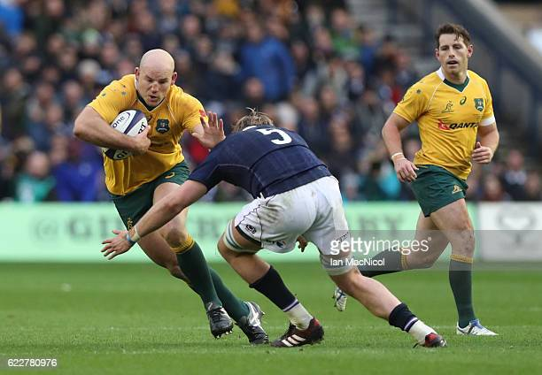 Stephen Moore of Australia is tackled by Jonny Gray of Scotland during the Scotland v Australia Autumn Test Match at Murrayfield Stadium on November...