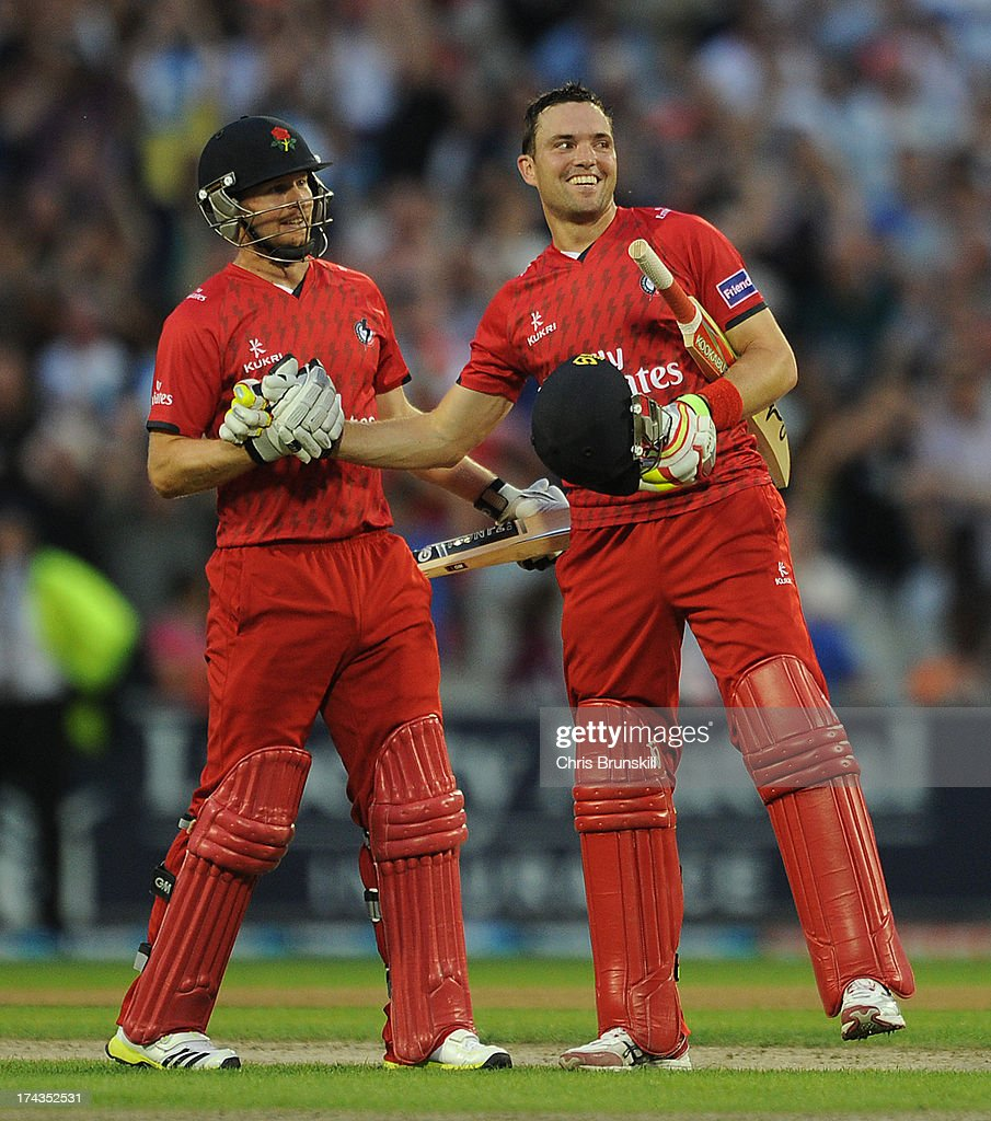 Stephen Moore (R) of Lancashire Lightning celebrates victory with team-mate Karl Brown following the Friends Life T20 match between Lancashire Lightning and Yorkshire Carnegie at Old Trafford on July 24, 2013 in Manchester, England.