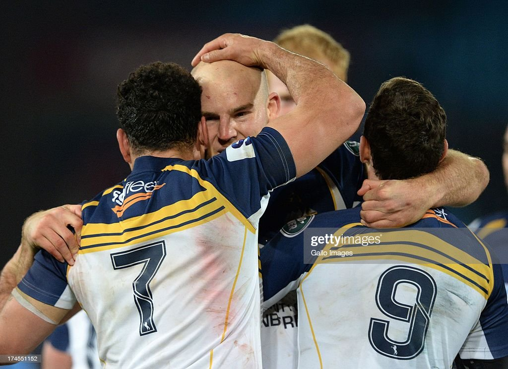 Stephen Moore of the Brumbies celebrates with George Smith (L) and Nic White (R) after victory in the SupeRugby semi final match between Vodacom Bulls and Brumbies at Loftus Versfeld Stadium on July 27, 2013 in Pretoria, South Africa.