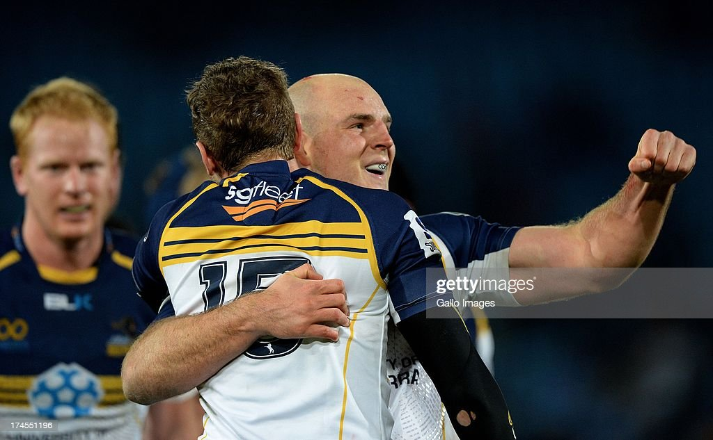 Stephen Moore (R) of the Brumbies celebrates with Jesse Mogg after victory in the SupeRugby semi final match between Vodacom Bulls and Brumbies at Loftus Versfeld Stadium on July 27, 2013 in Pretoria, South Africa.