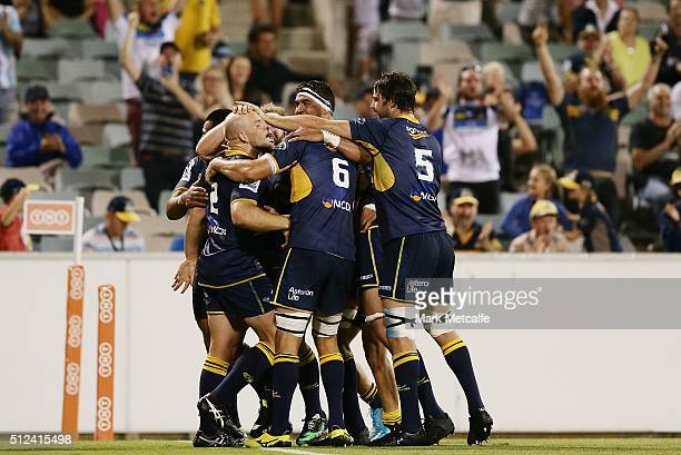Stephen Moore of the Brumbies celebrates with team mates after David Pocock scores a try during the round one Super Rugby match between the Brumbies...