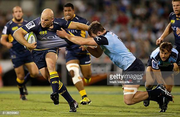Stephen Moore of the Brumbies is tackled by Jed Holloway of the Waratahs during the round two NRL match between the Brumbies and the Waratahs at GIO...