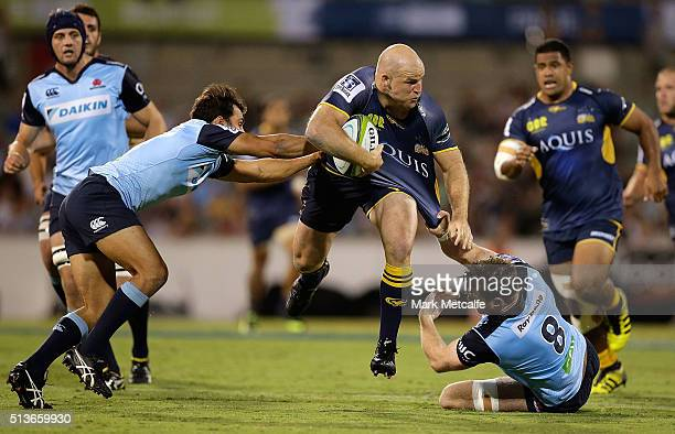 Stephen Moore of the Brumbies is tackled by Nick Phipps and Jed Holloway of the Waratahs during the round two NRL match between the Brumbies and the...