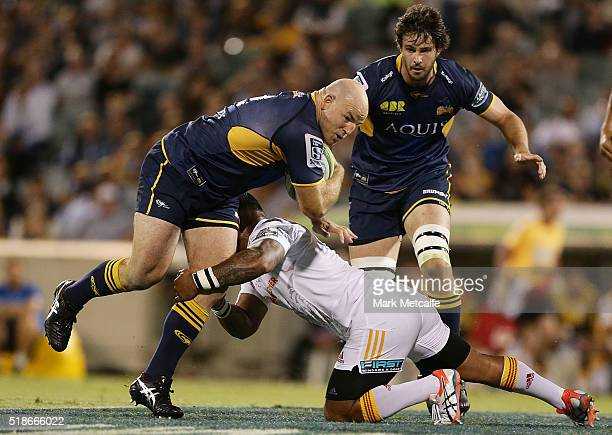 Stephen Moore of the Brumbies is tackled during the round six Super Rugby match between the Brumbies and the Chiefs at GIO Stadium on April 2 2016 in...