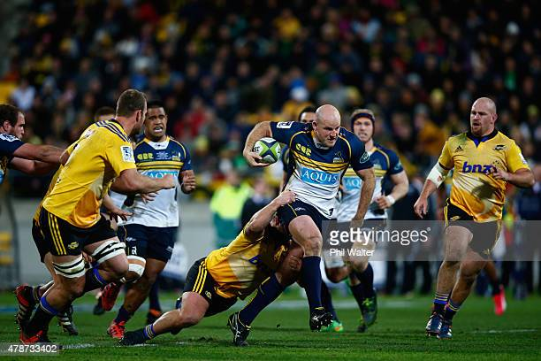 Stephen Moore of the Brumbies is tackled during the Super Rugby Semi Final match between the Hurricanes and the Brumbies at Westpac Stadium on June...