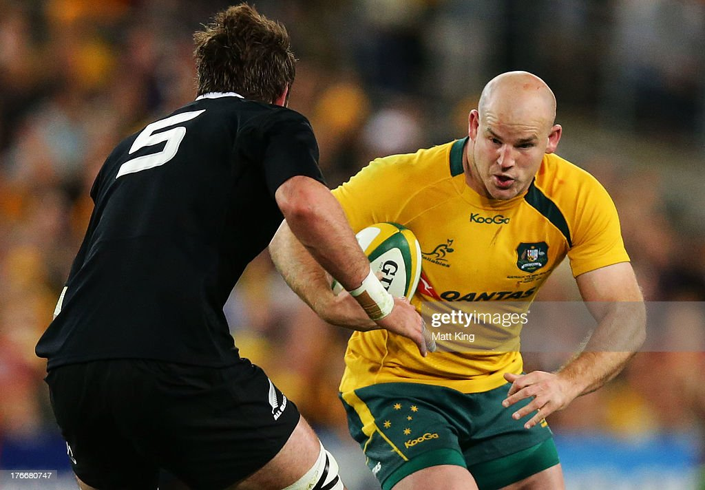 Stephen Moore of the Wallabies runs at Sam Whitelock of the All Blacks during The Rugby Championship Bledisloe Cup match between the Australian Wallabies and the New Zealand All Blacks at ANZ Stadium on August 17, 2013 in Sydney, Australia.