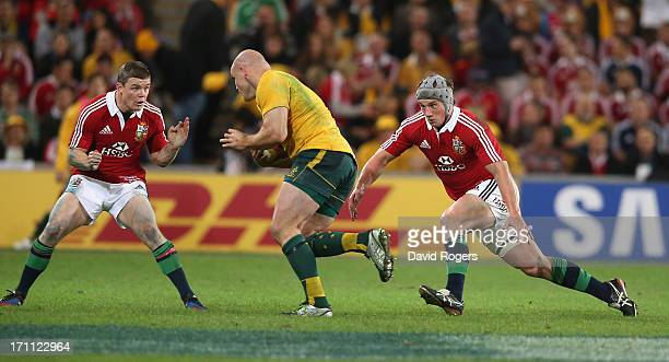 Stephen Moore of the Wallabies takes on Brian O'Driscoll and Jonathan Davies during the First Test match between the Australian Wallabies and the...