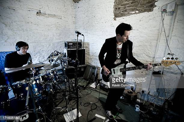 Stephen Morris and Tom Chapman of New Order perform in the band's rehearsal studio UK 22nd September 2011