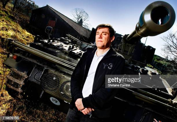 COVERAGE ** Stephen Morris of Joy Division and New Order poses for private portrait session with one of his collection of tanks an Abbot Self...