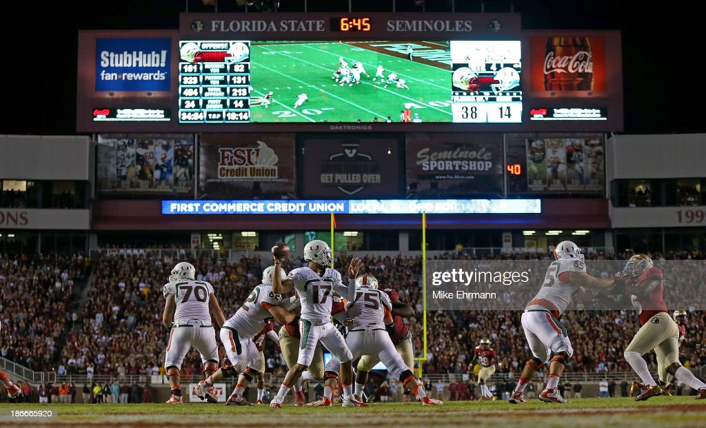 Stephen Morris of the Miami Hurricanes passes during a game against the Florida State Seminoles at Doak Campbell Stadium on November 2 2013 in...