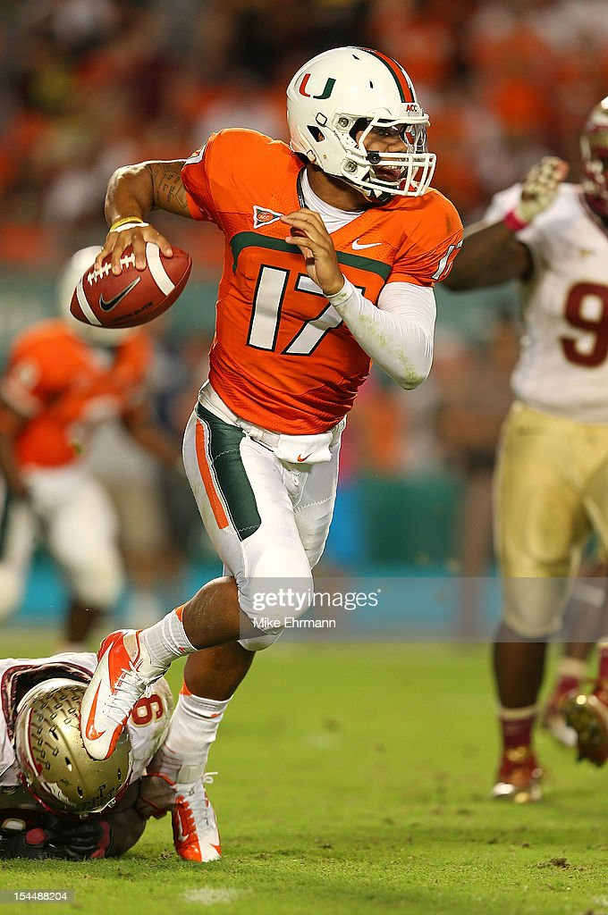 Stephen Morris #17 of the Miami Hurricanes scrambles during a game against the Florida State Seminoles at Sun Life Stadium on October 20, 2012 in Miami Gardens, Florida.
