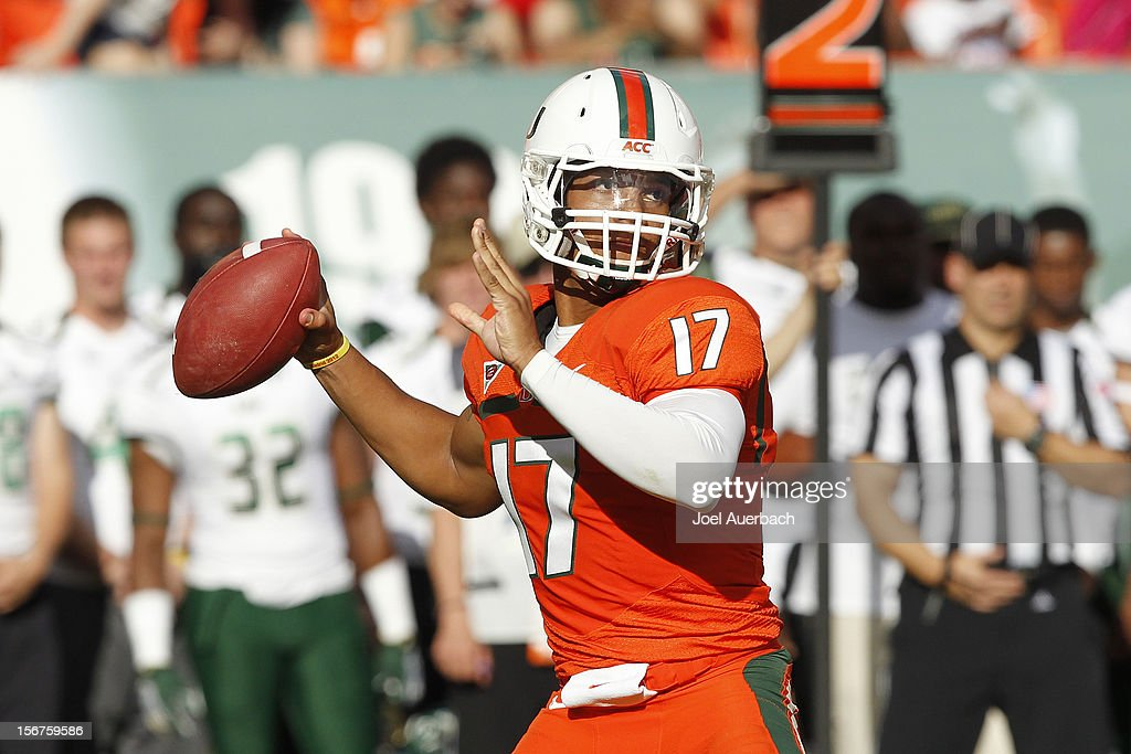 Stephen Morris #17 of the Miami Hurricanes throws the ball against the South Florida Bulls on November 17, 2012 at Sun Life Stadium in Miami Gardens, Florida. The Hurricanes defeated the Bulls 40-9.
