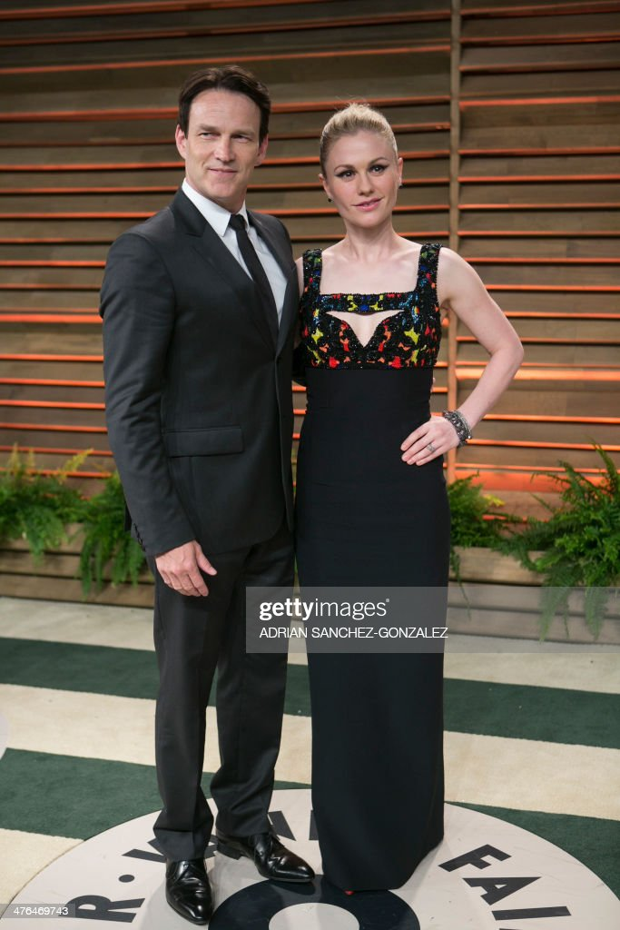Stephen Moyer (L) and Anna Paquin arrive at the 2014 Vanity Fair Oscar Party on March 2, 2014 in West Hollywood, California.