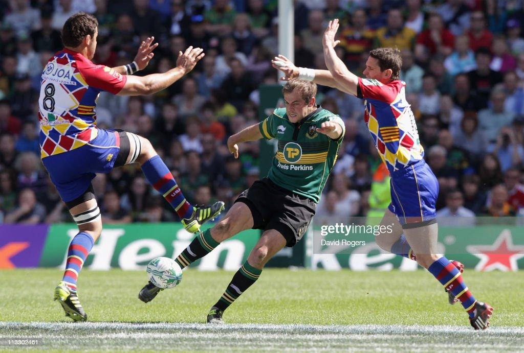 Stephen Myler of Northampton kicks the ball upfield past Damien Chouly and Nicolas Laharrague during the Heineken Cup semi final match between...