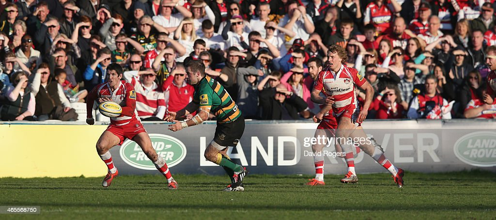Stephen Myler of Northampton passes the ball during the Aviva Premiership match Gloucester and Northampton Saints Kingsholm on March 7 2015 in Gloucester, England.