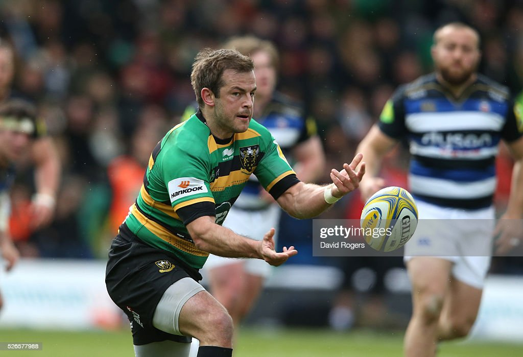 Stephen Myler of Northampton passes the ball during the Aviva Premiership match between Northampton Saints and Bath at Franklin's Gardens on April 30, 2016 in Northampton, England.