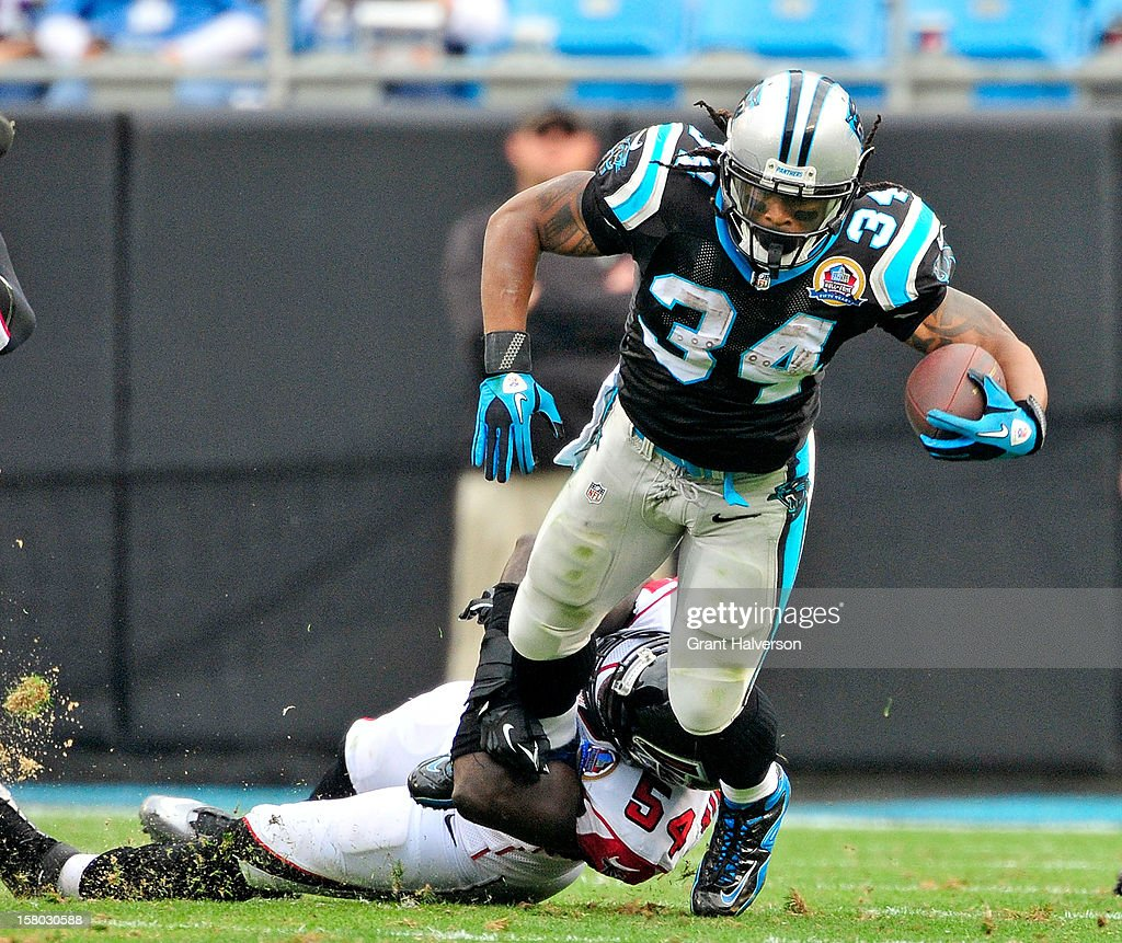 Stephen Nicholas #54 of the Atlanta Falcons tackles <a gi-track='captionPersonalityLinkClicked' href=/galleries/search?phrase=DeAngelo+Williams&family=editorial&specificpeople=618130 ng-click='$event.stopPropagation()'>DeAngelo Williams</a> #34 of the Carolina Panthers during play at Bank of America Stadium on December 9, 2012 in Charlotte, North Carolina. Carolina defeated Atlanta, 30-20.