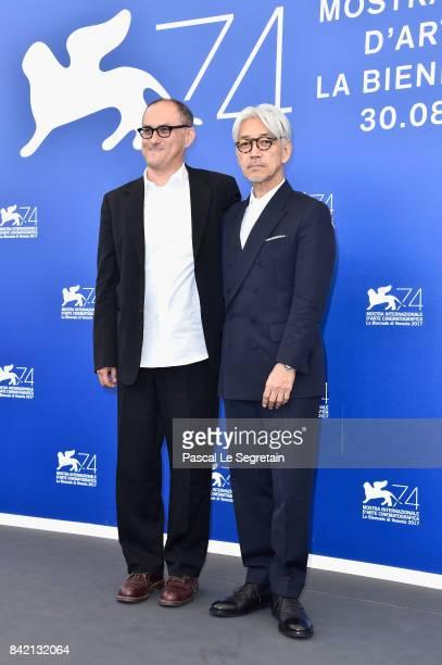 Stephen Nomura Schible and Ryuichi Sakamoto attend the 'Ryuichi Sakamoto Coda' photocall during the 74th Venice Film Festival at Sala Casino on...