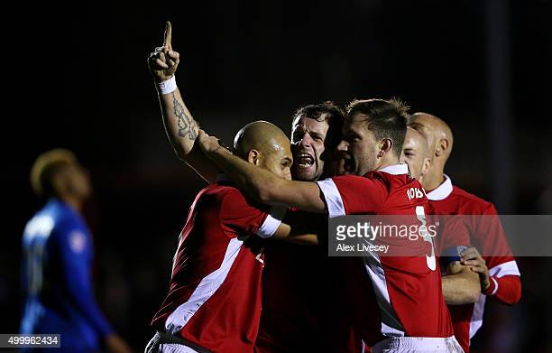 Stephen O'Halloran of Salford City celebrates with his team mates after scoring his side's first goal during the Emirates FA Cup Second Round match...