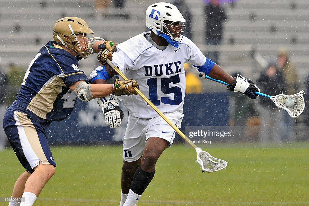 Stephen O'Hara #4 of the Notre Dame Fighting Irish checks Myles Jones #15 of the Duke Blue Devils at Koskinen Stadium on February 16, 2013 in Durham, North Carolina. Notre Dame defeated Duke 13-5.
