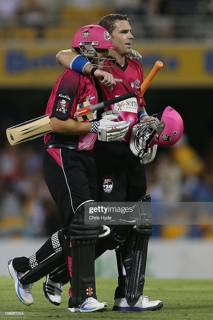 Stephen O'Keefe and Michael Lumb of the Sixers celebrate winning the Big Bash League match between the Brisbane Heat and the Sydney Sixers at The Gabba on January 7, 2013 in Brisbane, Australia.