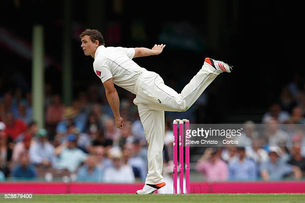 Stephen O'Keefe of Australia bowling during the first day of the third Test match between Australia and the West Indies at the Sydney Cricket Ground...