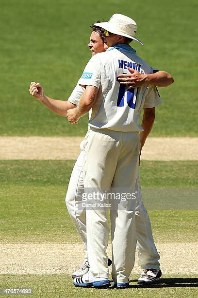 Stephen O'Keefe of the Blues celebrates the wicket of Callum Feguson of the Redbacks with his team mate Scott Henry of the Blues during day two of...