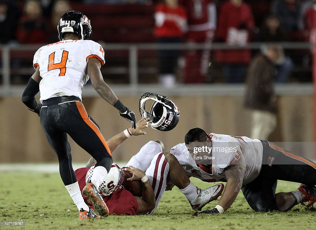 Stephen Paea #54 of the Oregon State Beavers loses his helmet as he tackles Tyler Gaffney #25 of the Stanford Cardinal at Stanford Stadium on November 27, 2010 in Palo Alto, California.
