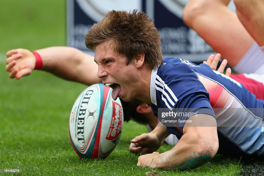 Stephen Parez of France scores a try during the Bowl Quarter Final match between England and France during day three of the 2013 Hong Kong Sevens at...