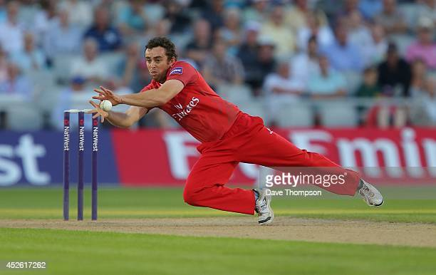 Stephen Parry of Lancashire Lightning fields the ball off his own bowling during the Natwest T20 Blast match between Lancashire Lightning and Durham...