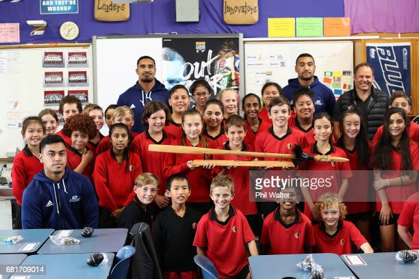Stephen Perofeta Jerome Kaino and Jimmy Tupou of the Blues pose with children during the New Zealand Lions Series Education Programme Launch at...