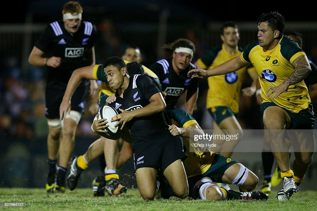 Stephen Perofeta of New Zealand is tackled during the Under 20s Oceania Rugby match between Australia and New Zealand at Bond University on May 3, 2016 in Gold Coast, Australia.