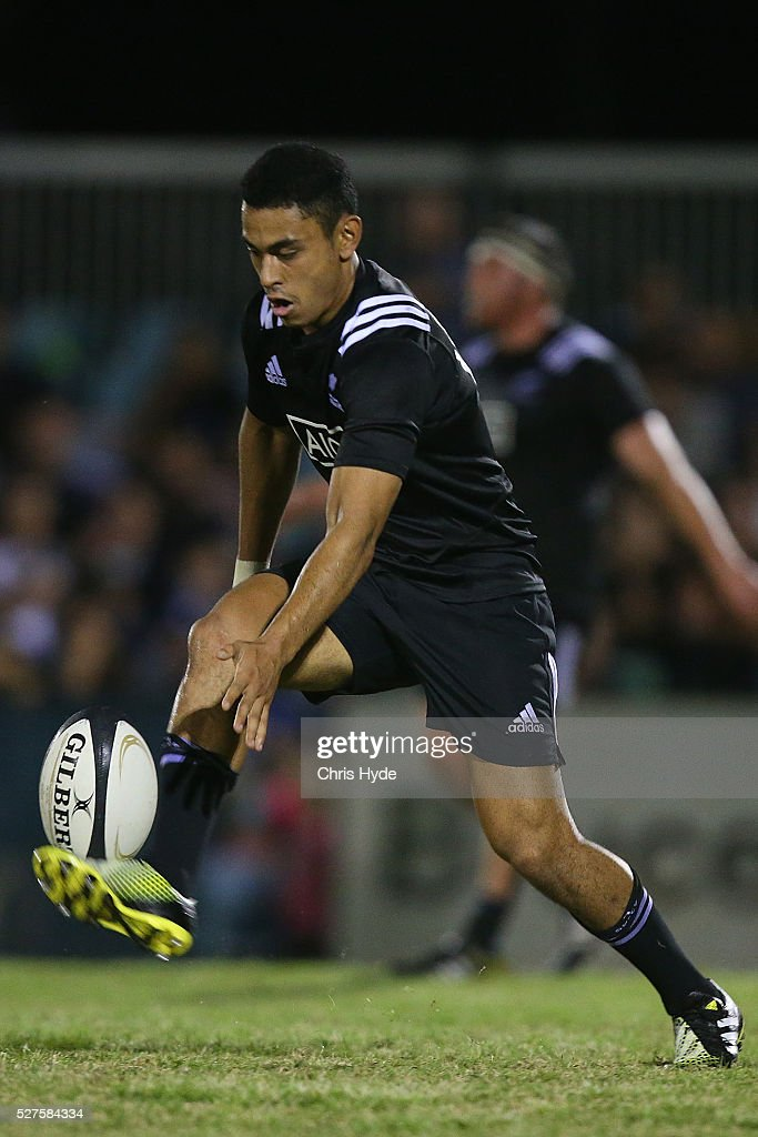 Stephen Perofeta of New Zealand kicks the ball during the Under 20s Oceania Rugby match between Australia and New Zealand at Bond University on May 3, 2016 in Gold Coast, Australia.