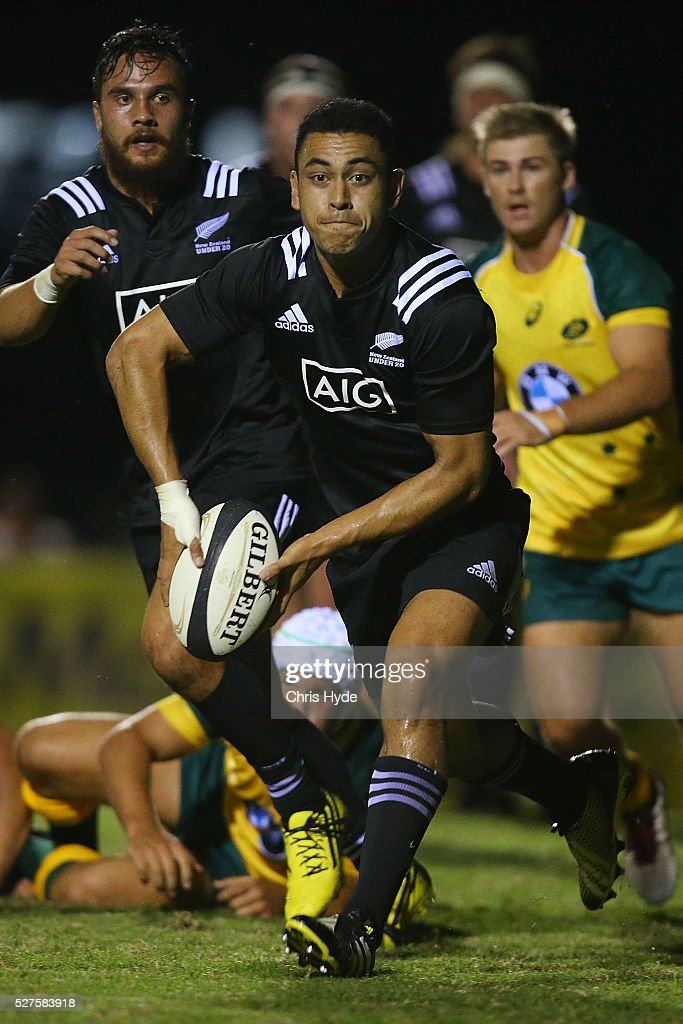 Stephen Perofeta of New Zealand passes the ball during the Under 20s Oceania Rugby match between Australia and New Zealand at Bond University on May 3, 2016 in Gold Coast, Australia.