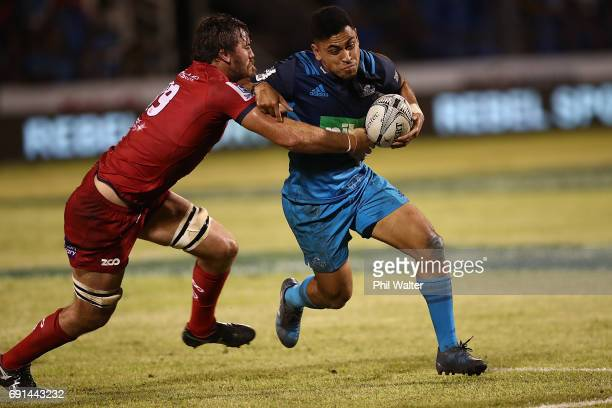 Stephen Perofeta of the Blues is tackled during the round 15 Super Rugby match between the Blues and the Reds at Apia Park National Stadium on June 2...